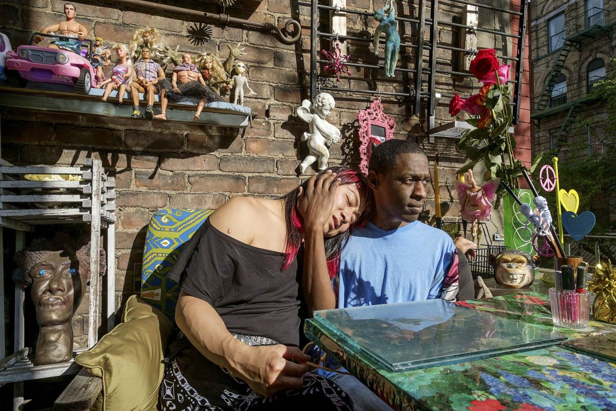 After working, KoKo and Ken enjoy their moment in KoKo's balcony, Manhattan, New York. May 13, 2015.