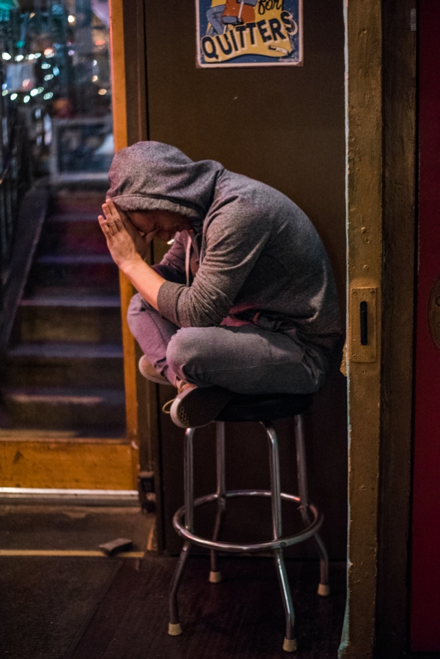 A stand up comedian gathers his thoughts before going onstage to perform for the first time at EastVille Comedy Club on October 27, 2015. ©Leda Costa