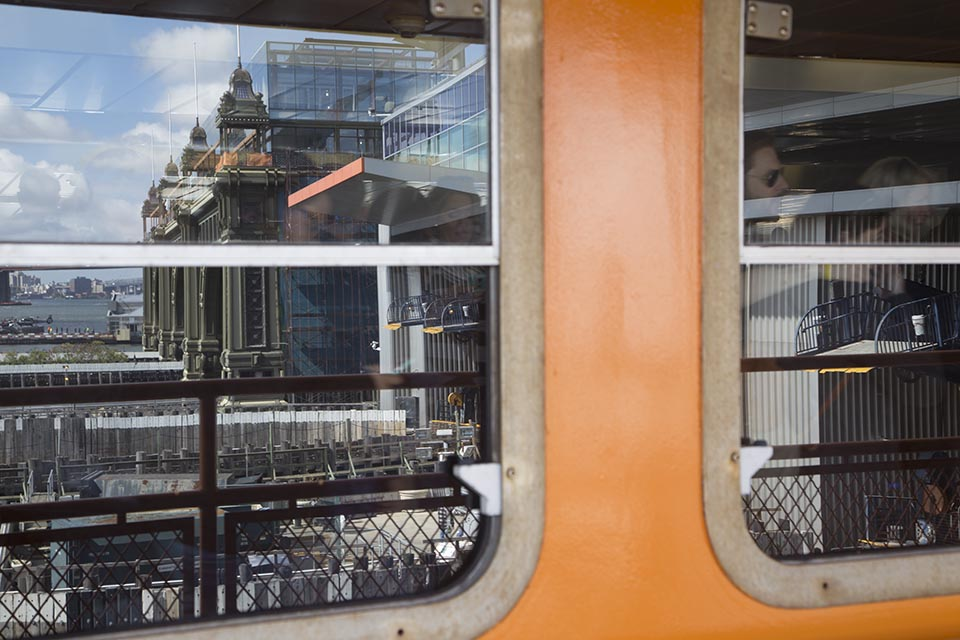 A reflection of the Manhattan ferry terminal as passengers disembark the Staten Island Ferry.