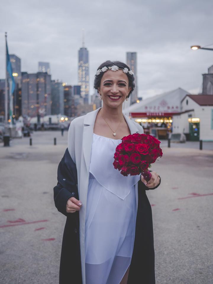 A woman taking wedding photos at Brooklyn Bridge Park on October 24, 2015. ©Mohamed Almannai