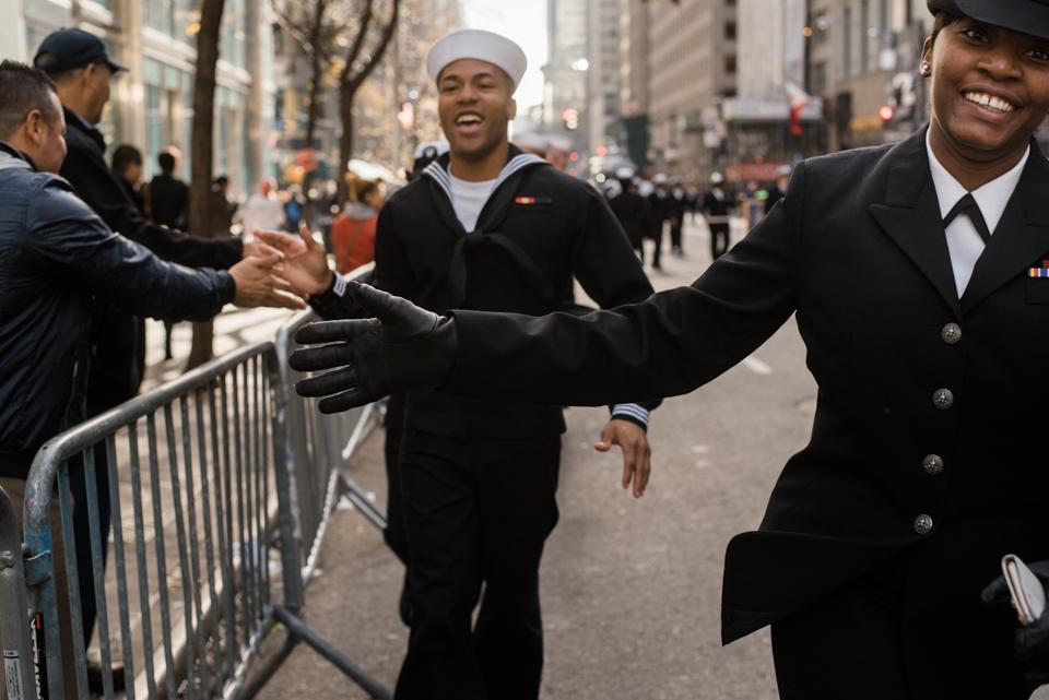 Navy Seamen high-fiving the crowd at America's Parade on November 11, 2015. ©Leda Costa