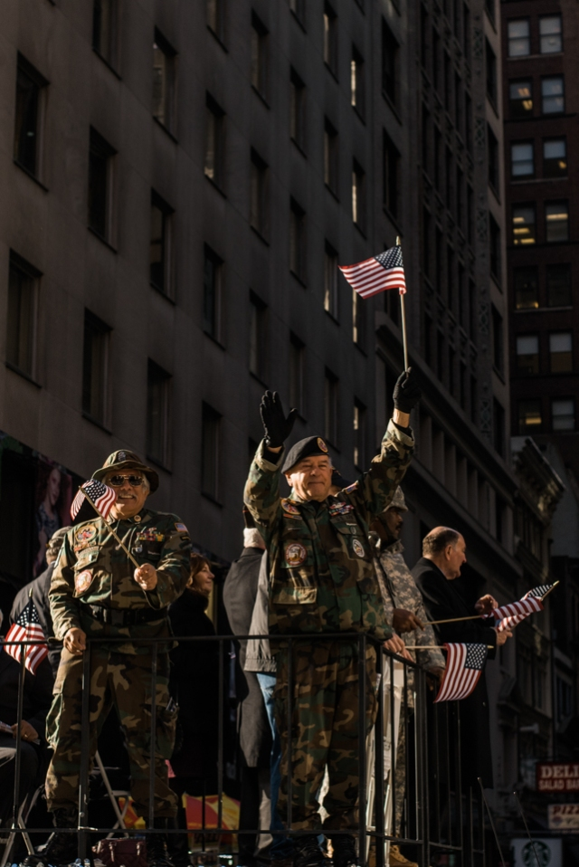 Vietnam veterans waving to the crowd at America's Parade on November 11, 2015. ©Leda Costa