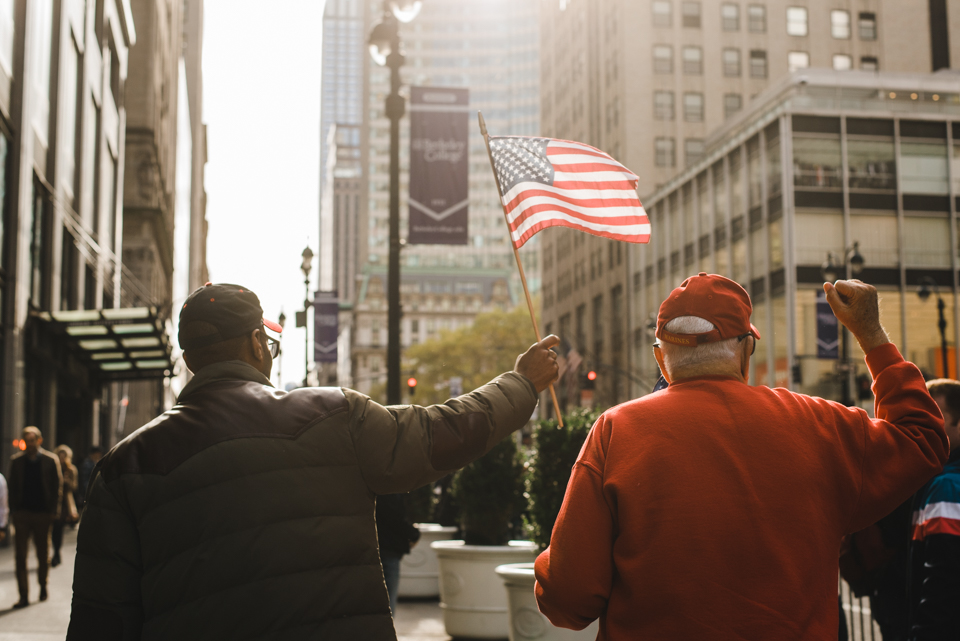 Two veterans cheering at America's Parade on November 11, 2015. ©Leda Costa