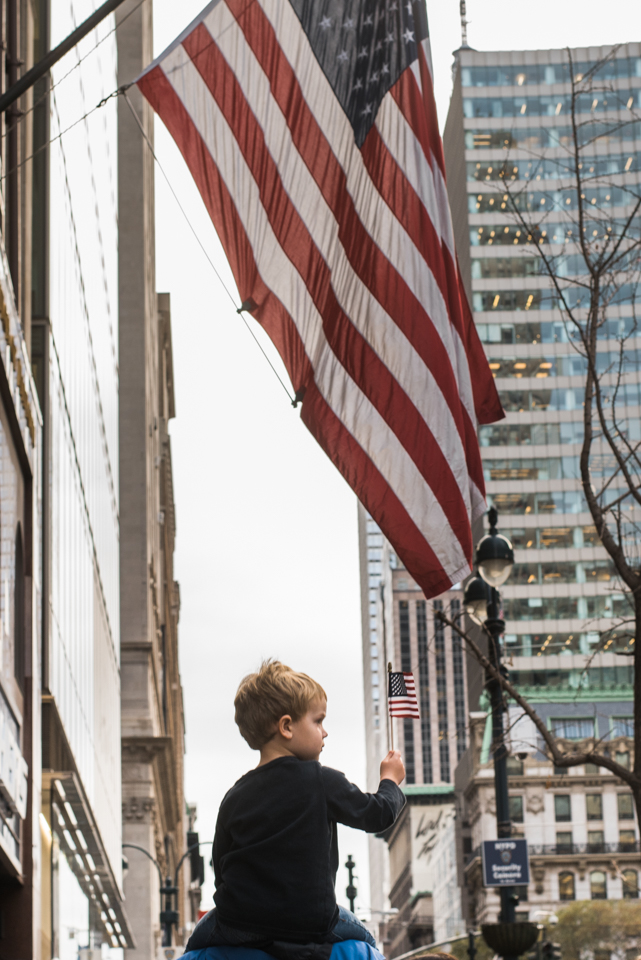 A child watches the parade from his father's shoulders on November 11, 2015. ©Leda Costa