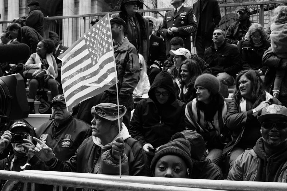 Spectators on the tribune in front of the NY Public Library.