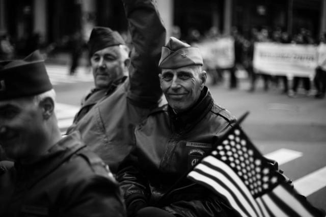 Veterans on a car greet the spectators.