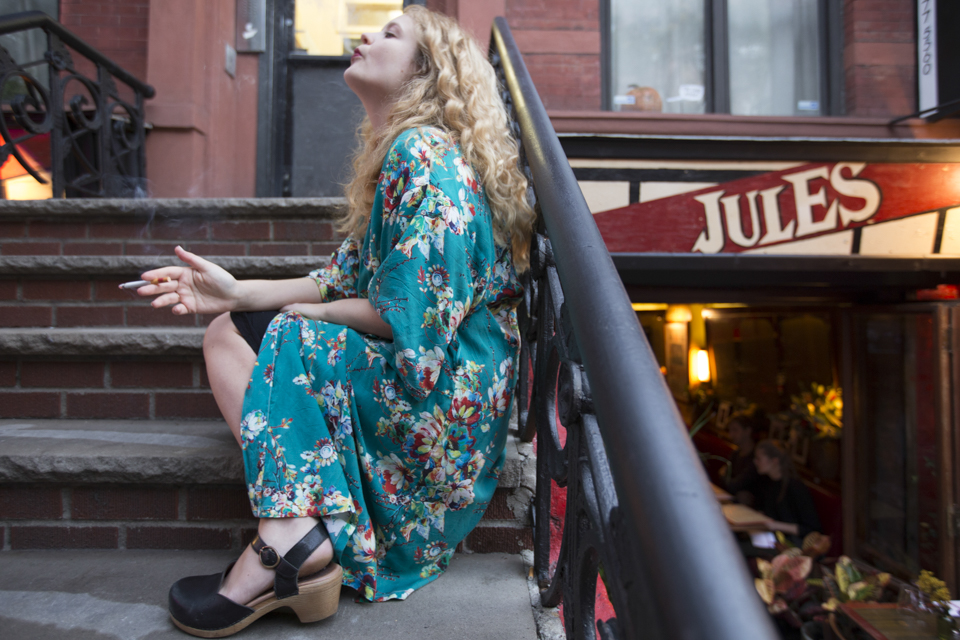 Lauren Rodgers smokes a cigarette outside her apartment in the East Village. ©Mamie Heldman