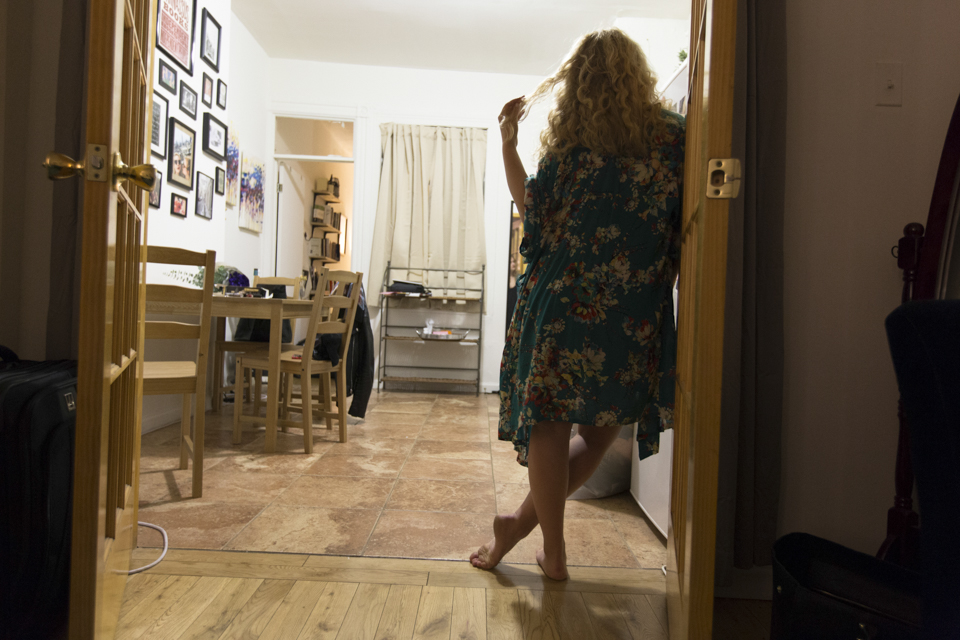 Lauren Rodgers waits for hot water to boil in her apartment in the East Village. ©Mamie Heldman