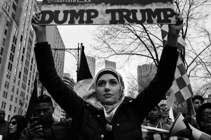 19 March 2016 - Manhattan, New York - A women wearing an American flag hijab marches at an anti-Trump rally. Republican candidate Donald J. Trump targeted muslims several times throughout his campaign and proposed a ban of muslims entering the U.S.