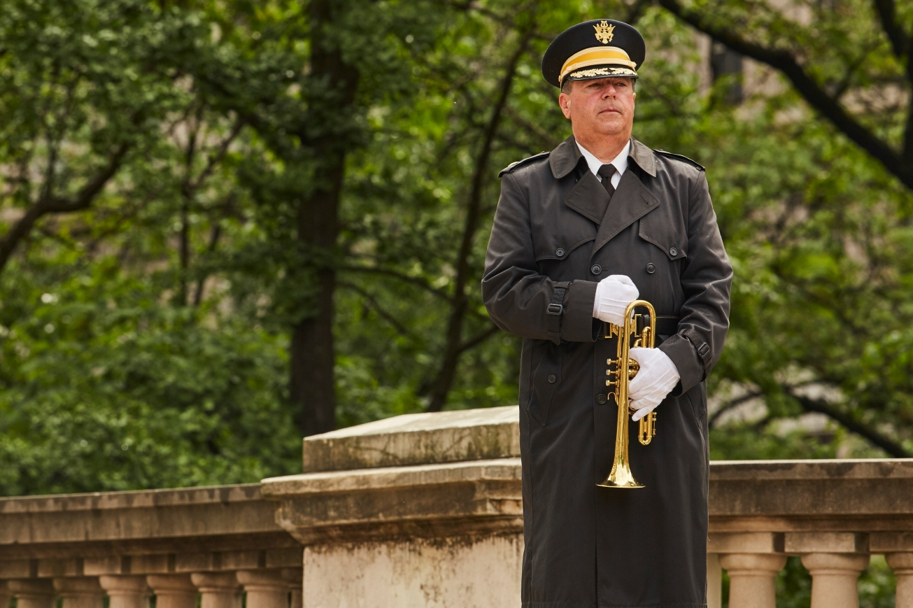 A member of the US Navy band prepares to play Taps for the end of the ceremony.
