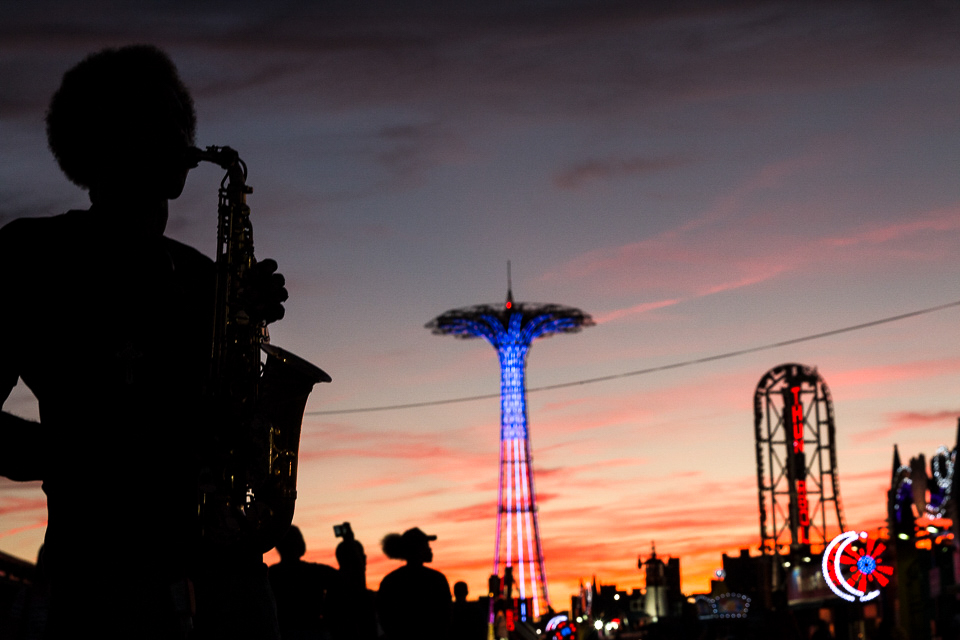 Musician at sunset - high contrast street, stranger