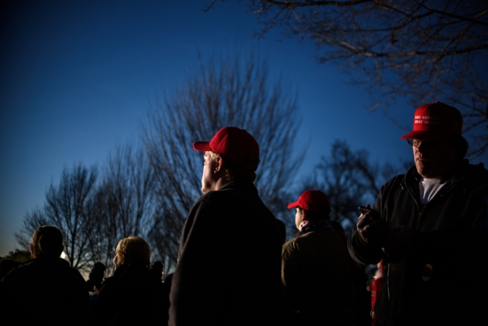 "Men in red ""Make America Great Again"" hats at the inaugural concert at the Lincoln Memorial in Washington D.C. on the eve of Donald Trump's inauguration as 45th president on January 19, 2017. (Photo by Monica Jorge)"